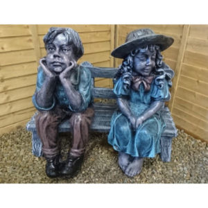 Bemused Boy and Girl on Bench