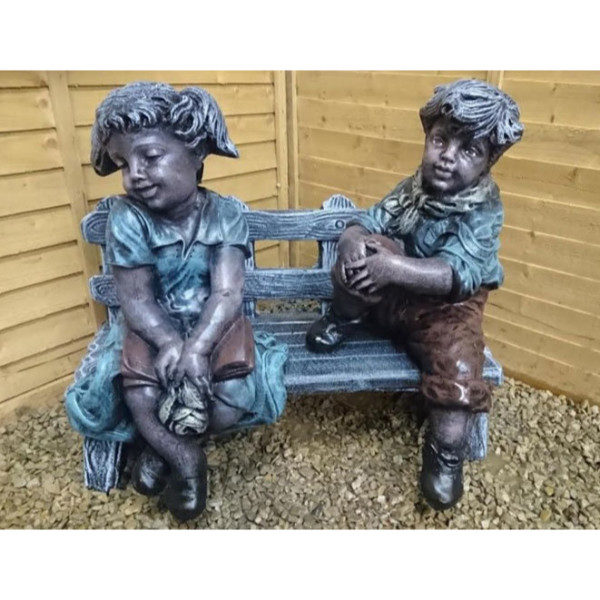 Boy and Shy Girl Sitting on Bench
